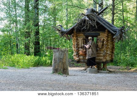 Natural Park Deer Streams, Russia - June 25, 2016: Fairy-tale characters Baba Yaga near the hut on chicken legs