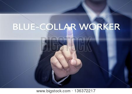 Businessman hand touching BLUE-COLLAR WORKER button on virtual screen