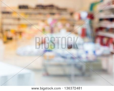 Blurred colorful products in abstract shop - background with shallow DOF
