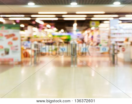 Abstract blurred entrance area of supermarket as background