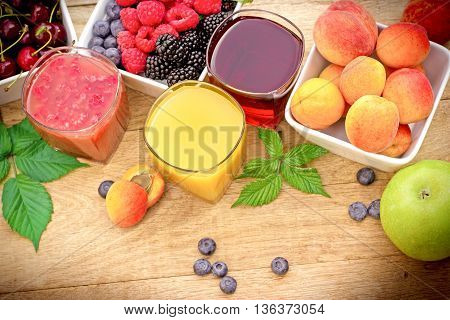 Healthy fruit juice made with organic fruits on table