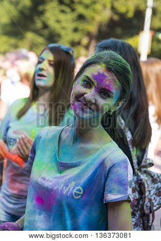 Lviv Ukraine - August 30 2015: Girl have fun during the festival of color in a city park in Lviv.