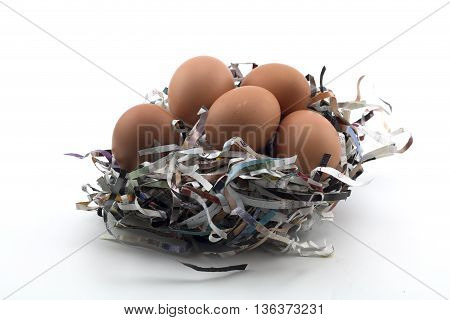 Eggs on the newspaper protection on a white background
