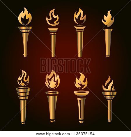 Set of golden torches, flaming gold torch simbol. Vector icon