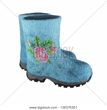 women's boots handmade from wool isolated on a white background