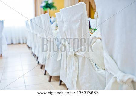 White wedding chairs on restaurant at wedding