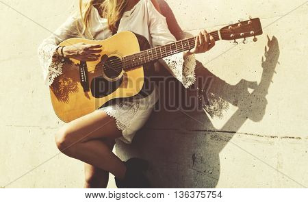 Girl Playing Guitar Writing Song Concept