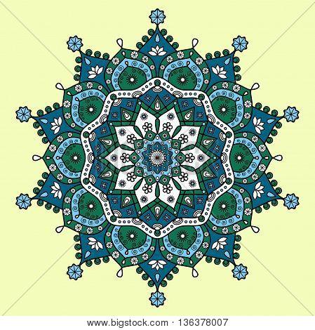 Mandala pattern in dark cyan blue, dark green, light blue & white on pale yellow background.