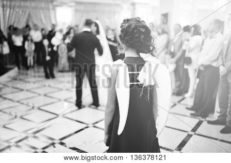 Wonderful Wedding Newlyweds Dancing At The Restaurant With Light. Children Girl With Wings Of Angel