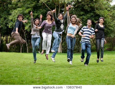 Group of happy people having fun outdoors