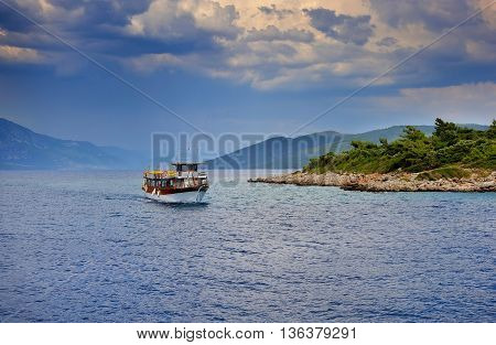 Beautiful Seascape With Boat And Rain Clouds. Aegean Sea. Turkey