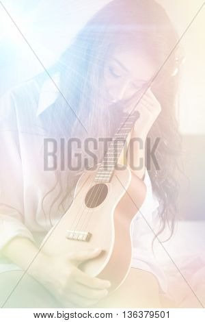 Beautiful Woman Hugging Ukulele With Loneliness In The Bedroom. Digital Art For Background.