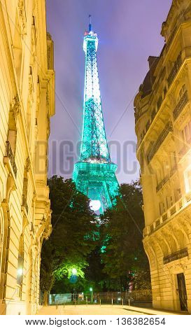 paris; France-June 27 2016 : The Eiffel tower lit up in green color for soccer Europe championship 2016 in France. The Eiffel tower is on of the most visited monuments in the world.