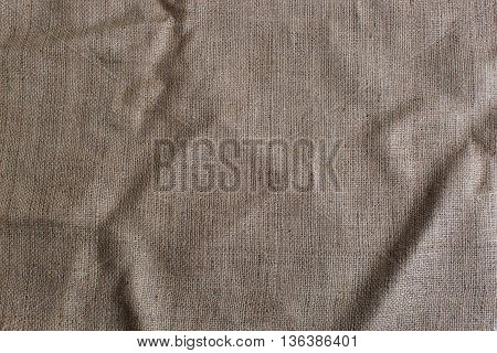 Texture of a sacking. Canvas fabric texture. Background of burlap hessian sacking. Brown fabric texture.