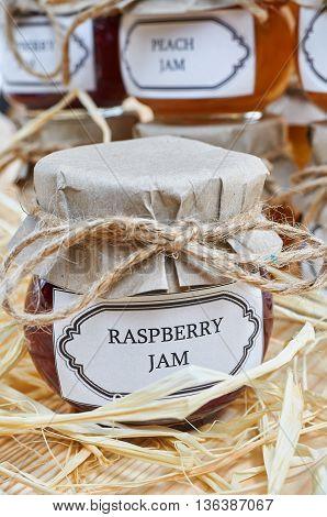 Home made jam on a wooden shelf