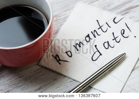Cup of coffee and napkin with message on paper napkin