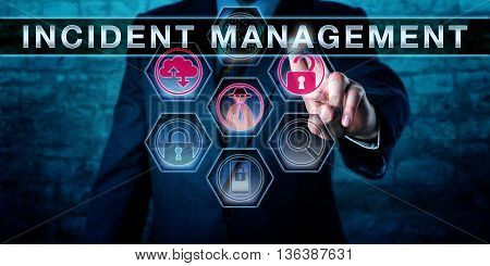 Male IT service manager is pressing INCIDENT MANAGEMENT on an interactive touch screen interface. Business metaphor cyber security and information technology service management concept.