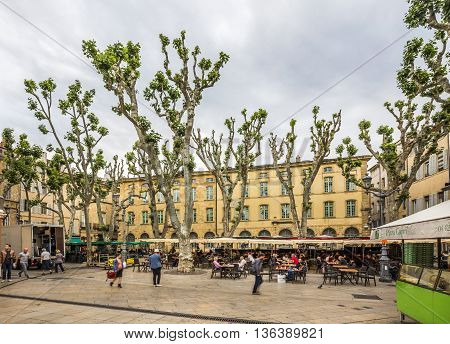 People Enjoy The Spring At The Place De Richelme In Aix-en-provence
