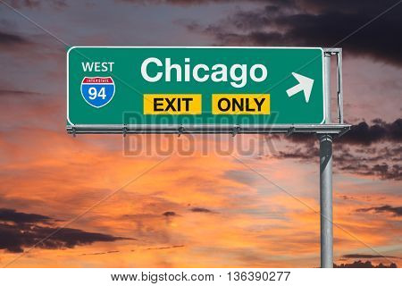 Chicago Illinois exit only freeway sign with sunrise sky.