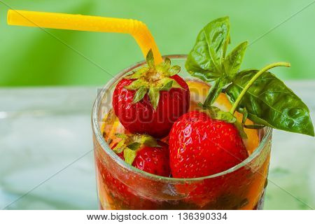 Summer strawberry beverage with fresh berries , close up view