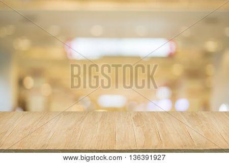 Wood floor with blur of bokeh of market background