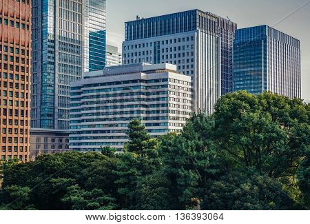 Tokyo Japan - February 27 2015. Modern glass and steel buildings of Marunouchi dsitrict in Tokyo