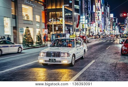 Tokyo Japan - February 27 2015. Man drives cab in Ginza district of Tokyo
