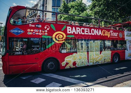 Barcelona Spain - May 23 2015. Tourists rides double decker bus on street in Barcelona