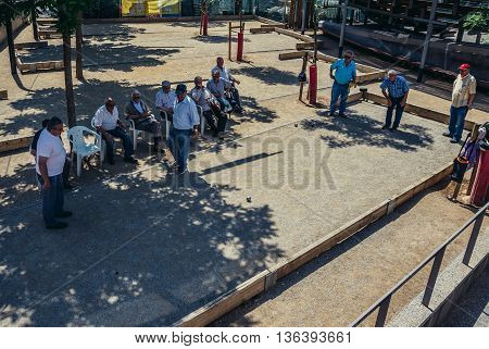 Barcelona Spain - May 26 2015. Men plays boules game in Barcelona