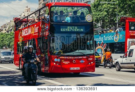 Barcelona Spain - May 26 2015. Tourists rides double decker bus at Passeig de Gracia one of the major avenues in Barcelona