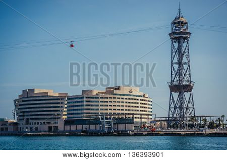 Barcelona Spain - May 26 2015. View of World Trade Center Barcelona building and Torre Jaume I tower of Port Vell Aerial Tramway