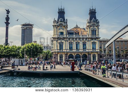 Barcelona Spain - May 26 2015. Tourists walks in front of Port Authority of Barcelona building