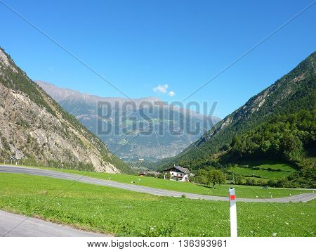 alps mountains peaks grass mountain road sky