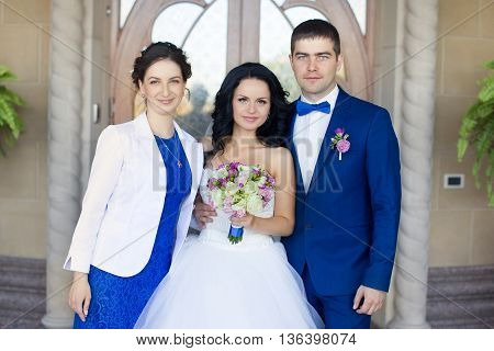 Newlyweds with friends posing for photo sharing