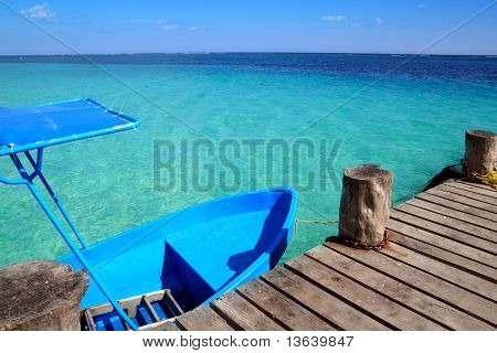 Blue Boat In Wooden Tropical Pier In Caribbean