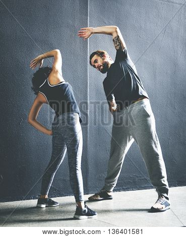 Stretching Athlete Couple Wellness Workout Fit Concept