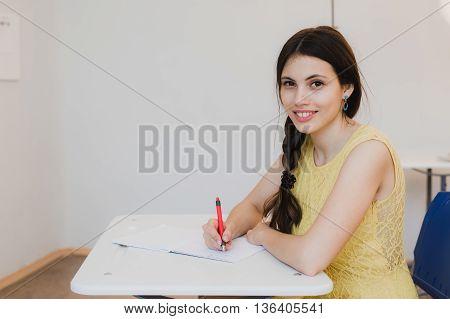 Female Teenage Student girl Studying In Classroom.