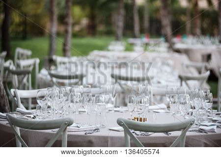 Tables decor in the restaurant on wedding day. Paster decorations, outdoor