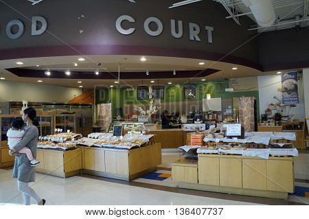 NAPERVILLE, ILLINOIS / UNITED STATES - NOVEMBER 3, 2015: One may purchase fresh baked items at the H Plaza food court in Naperville.