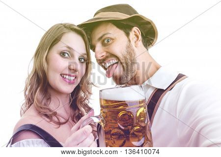 Young couple having fun with german beer