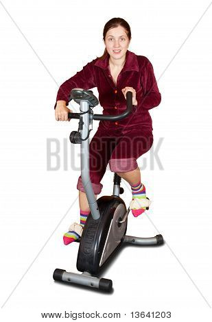 Girl Workout On Stationary Bicycle