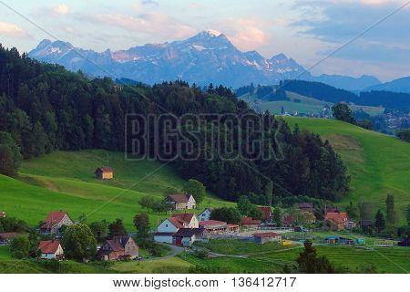 Eggersriet, Switzerland, June 28.2016: Mount Säntis seen from Eggersriet, Switzerland in the evening light.