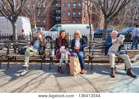 NEW YORK - CIRCA MARCH 2016: people sit on the bench in New York at daytime. The City of New York is the most populous city in the United States.