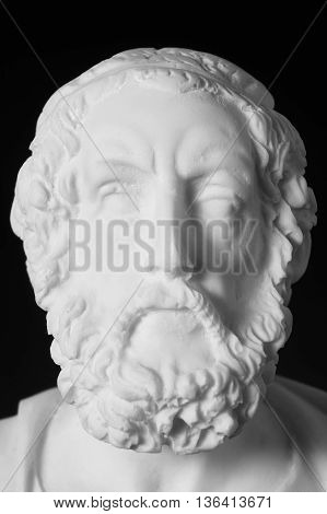 White Marble Bust Of The Greek Poet Homer Isolated On Black