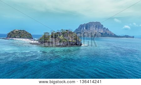 View of the beach between two rocky islands in Andaman sea, Thailand