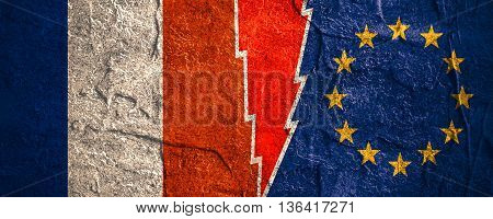 Image relative to politic relationships between European Union and France. National flags textured by concrete