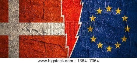 Image relative to politic relationships between European Union and Denmark. National flags divided by high voltage sign. Concrete textured