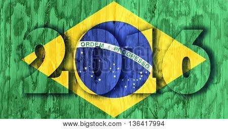 Brazil national flag and 2016 transparent numbers. Wood textured