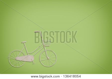 Vintage model bicycle on light green background.