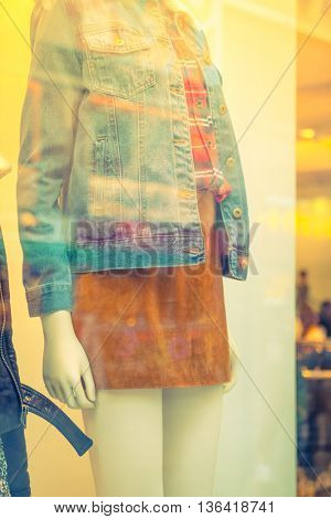 Woman dressed mannequins  In Fashion Shop ,Filtered image processed vintage effect.